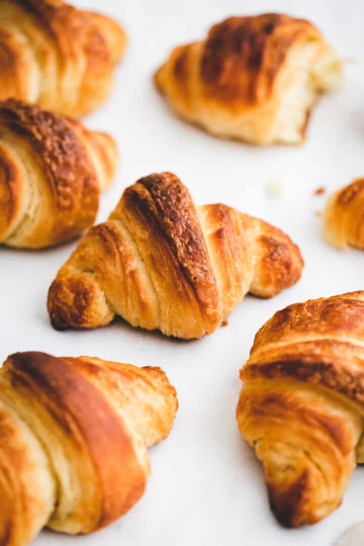 homemade croissants on a white table