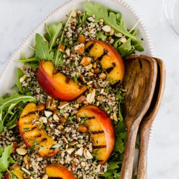 grilled peach salad on a serving platter