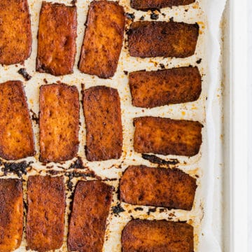 baked vegan bacon made with tofu on a baking tray