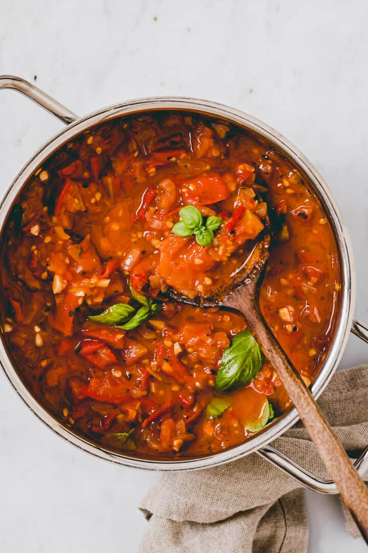 marinara sauce with fresh tomatoes in a pot
