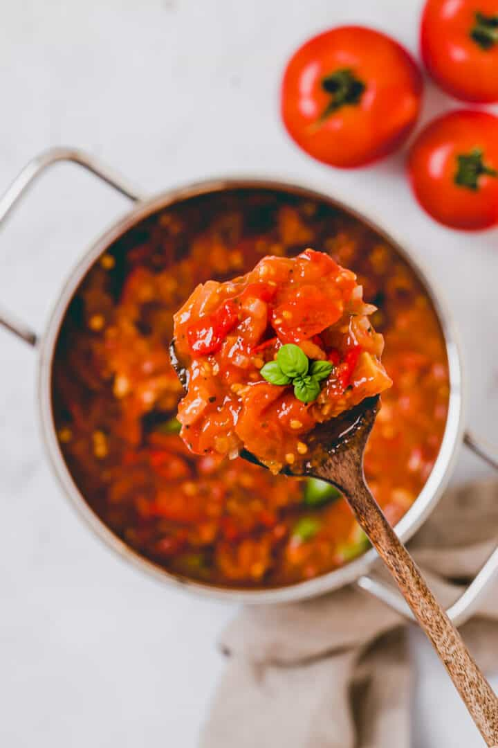 a spoon with homemade spaghetti sauce with fresh tomatoes