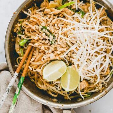 pad thai noodles served in a skillet