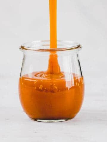vegan caramel sauce in a tulip jar