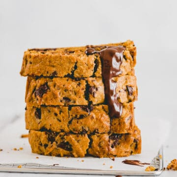 a stack of Vegan Pumpkin Chocolate Chip Bread slices