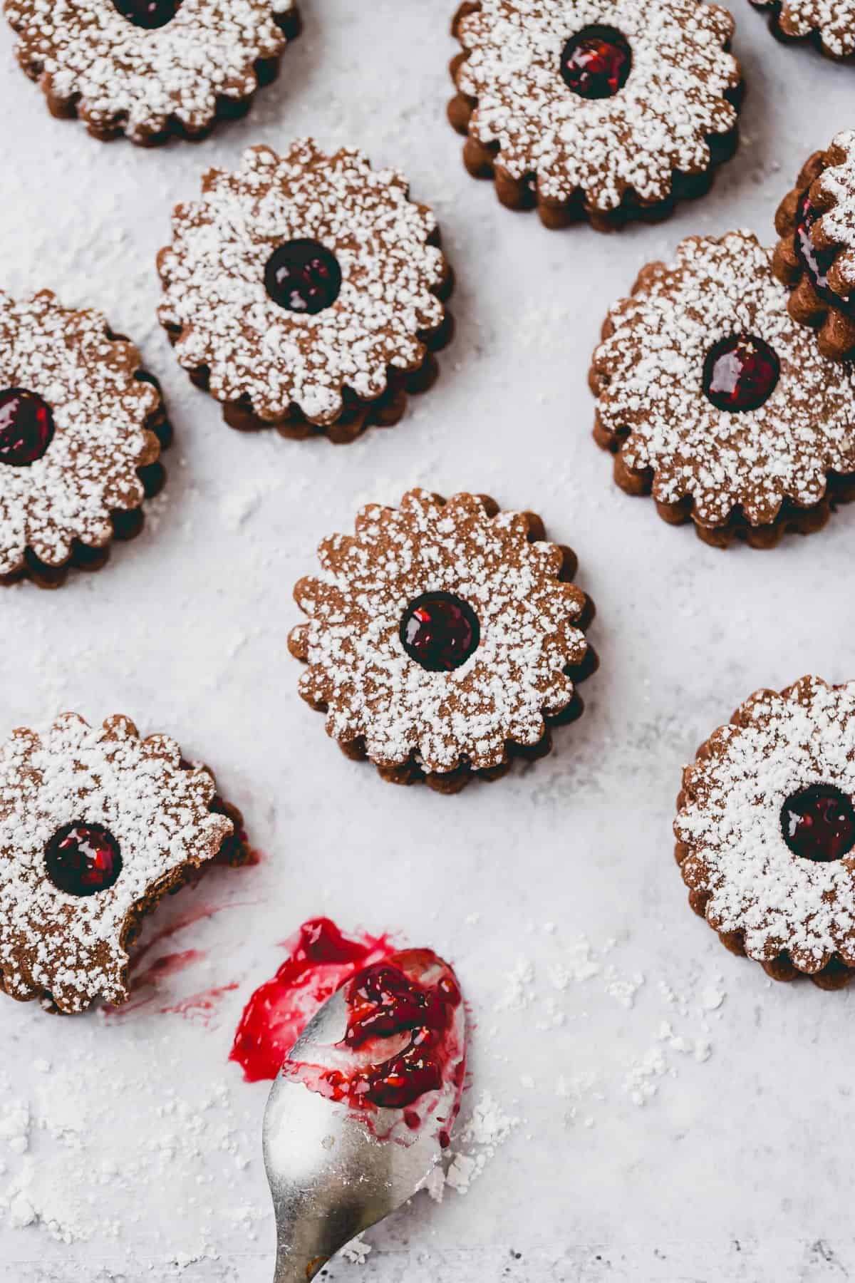 vegan linzer cookies with cacao powder and raspberry filling