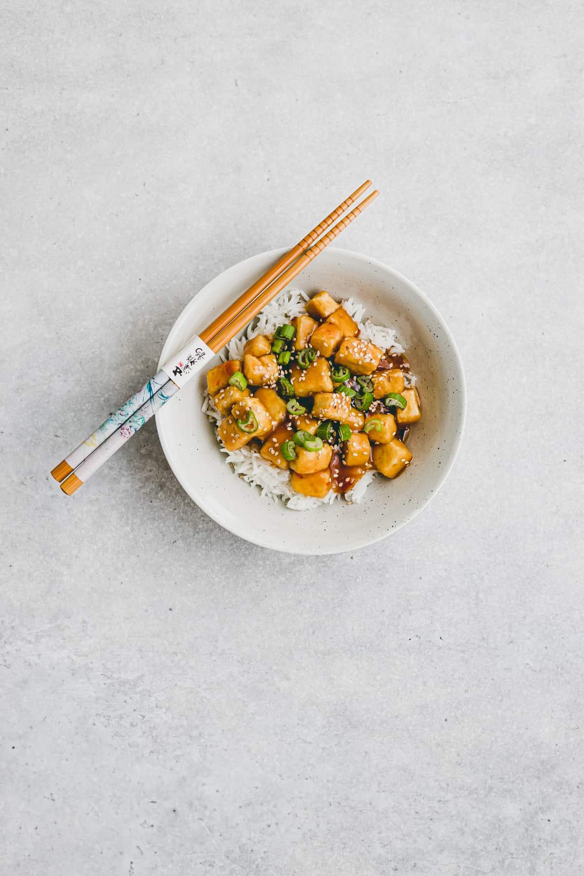 tofu orange chicken with panda express orange sauce in a bowl