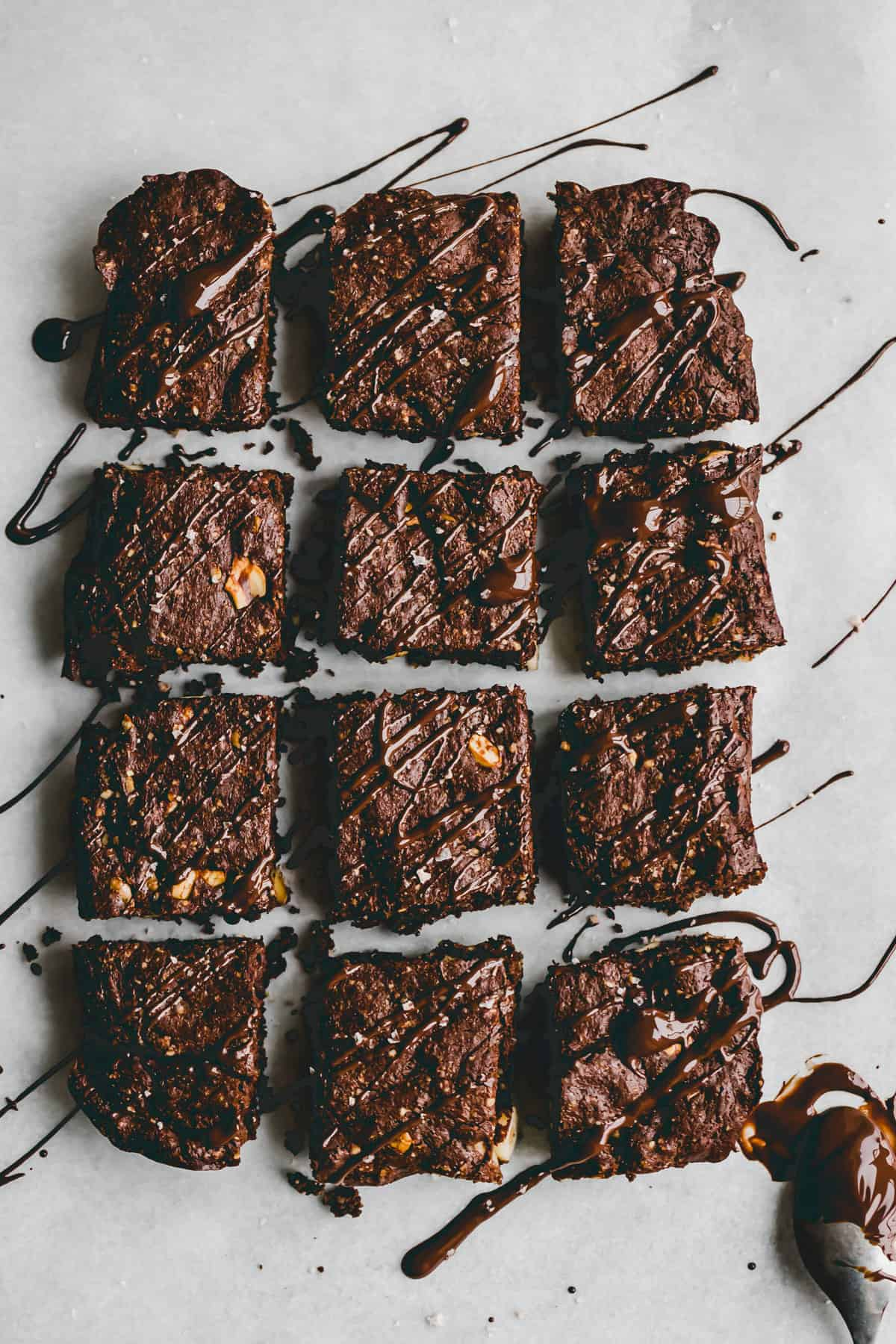 sliced gluten-free brownies drizzled with chocolate