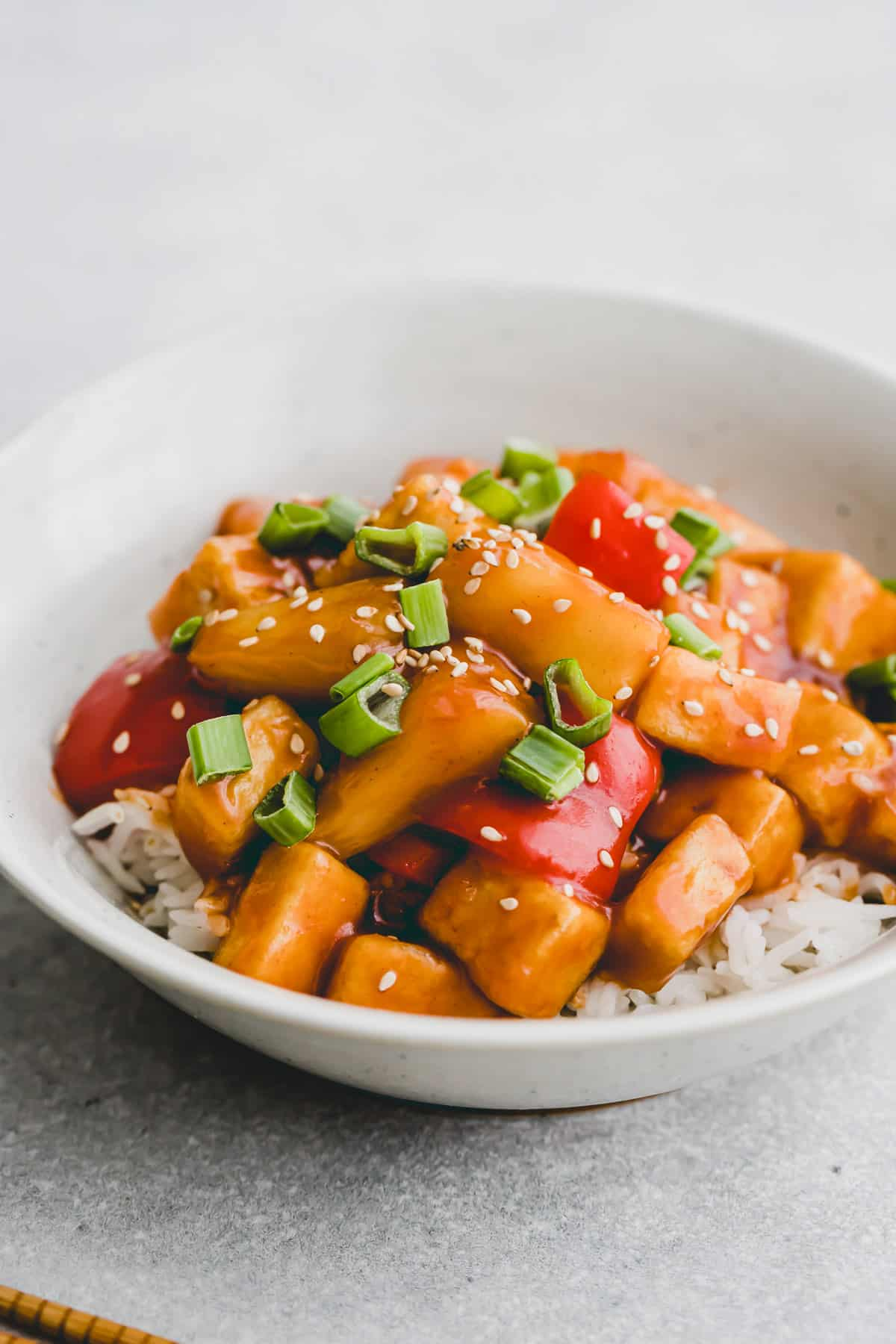 a bowl of tofu sweet and sour with rice