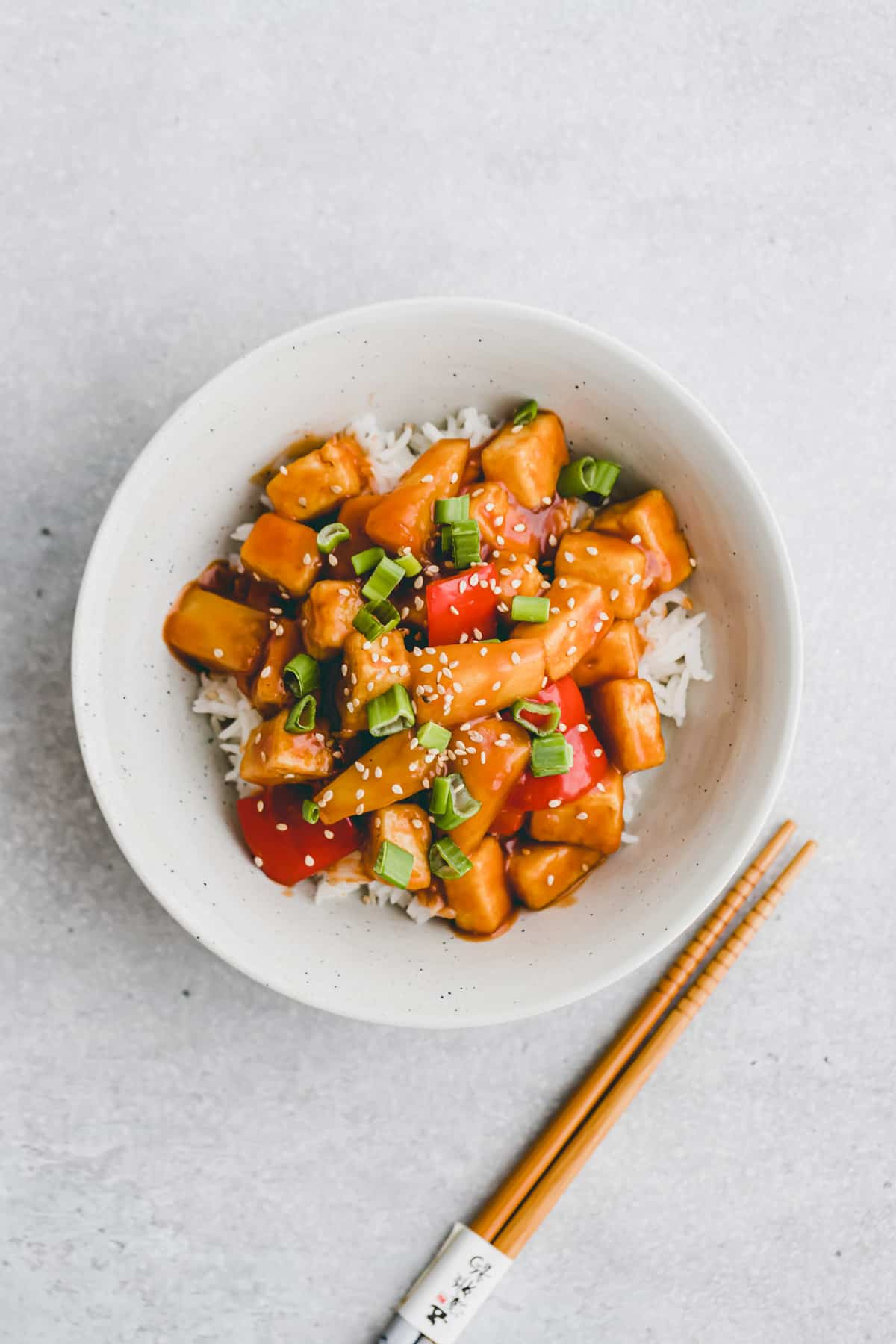 sweet and sour tofu served over rice