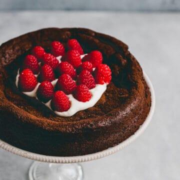 paleo flourless chocolate cake on a cake stand