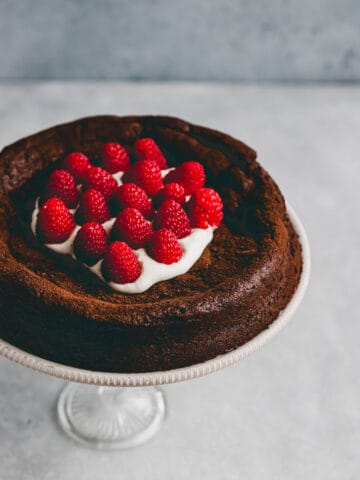 paleo flourless chocolate cake on a cake stand