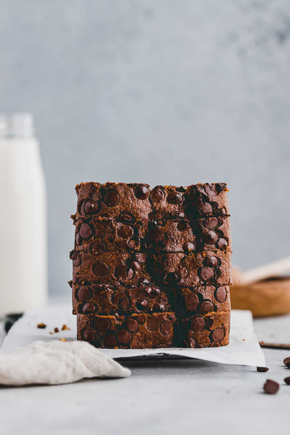 a stack of sliced chocolate chip zucchini bread