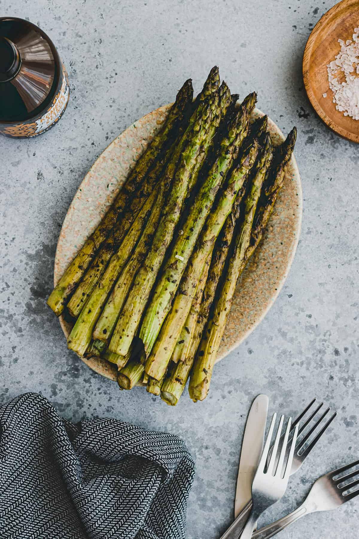 grilled asparagus on a serving platter