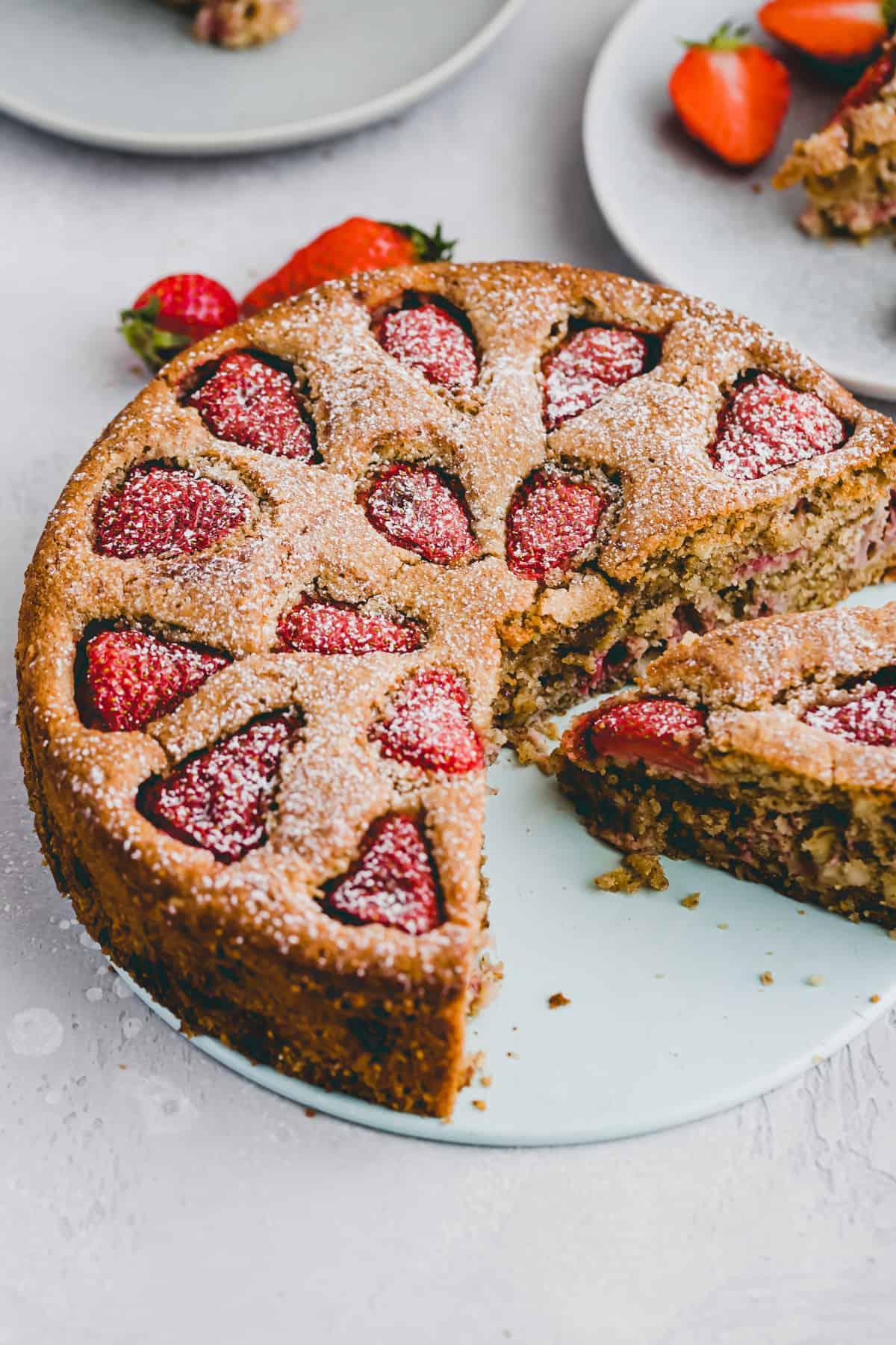 side angle shot of strawberry almond cake