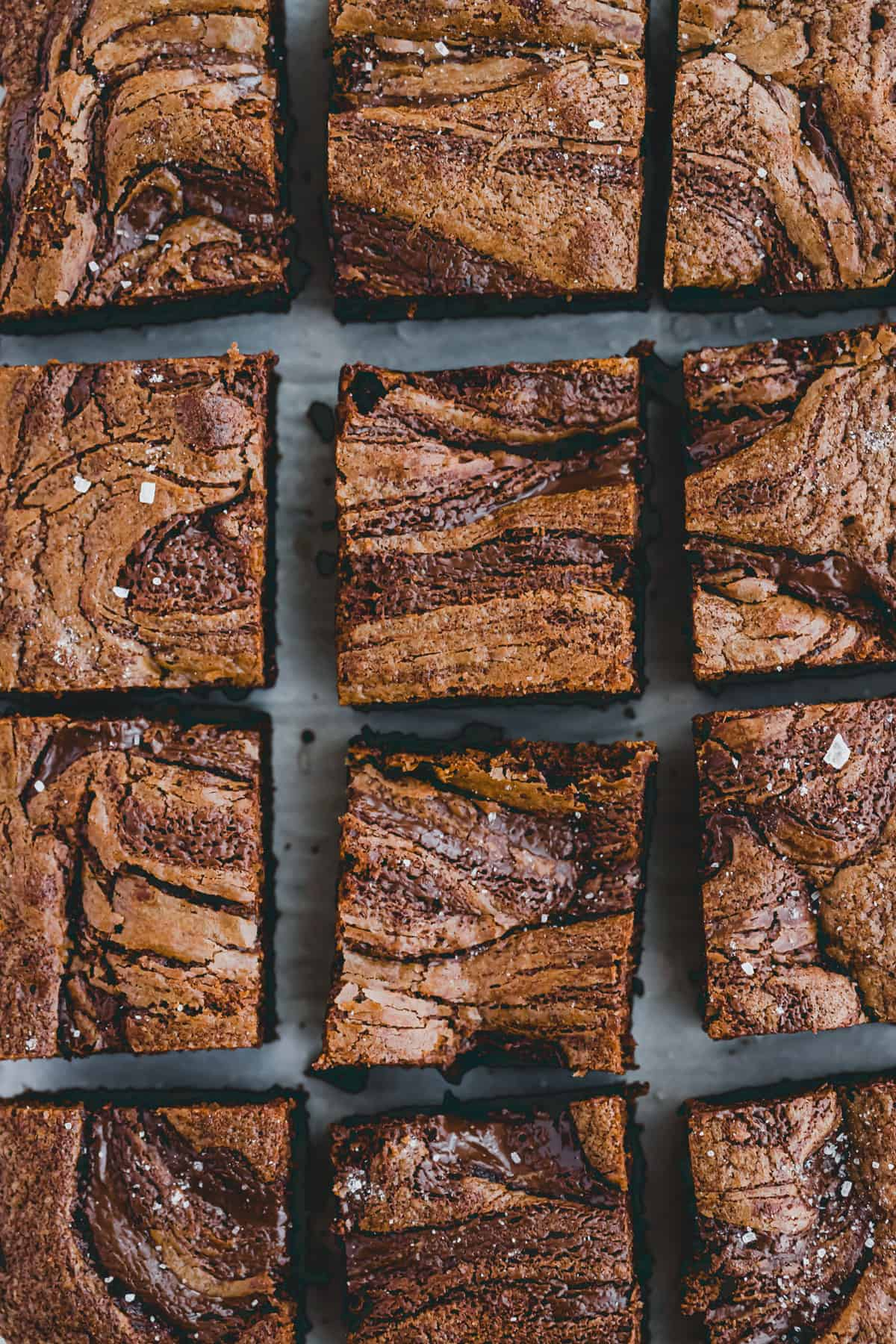 sliced nutella brownies on parchment paper