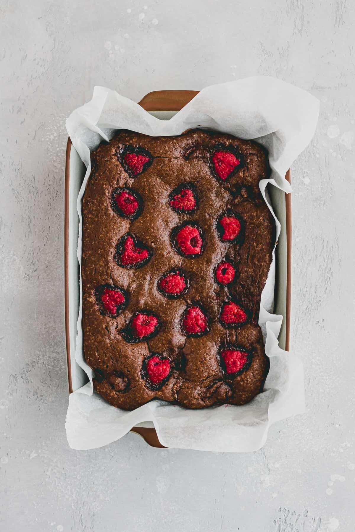chocolate raspberry brownies in a baking pan