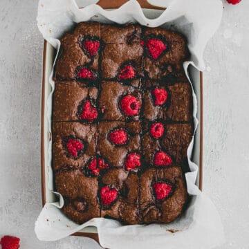 raspberry brownies in a baking pan