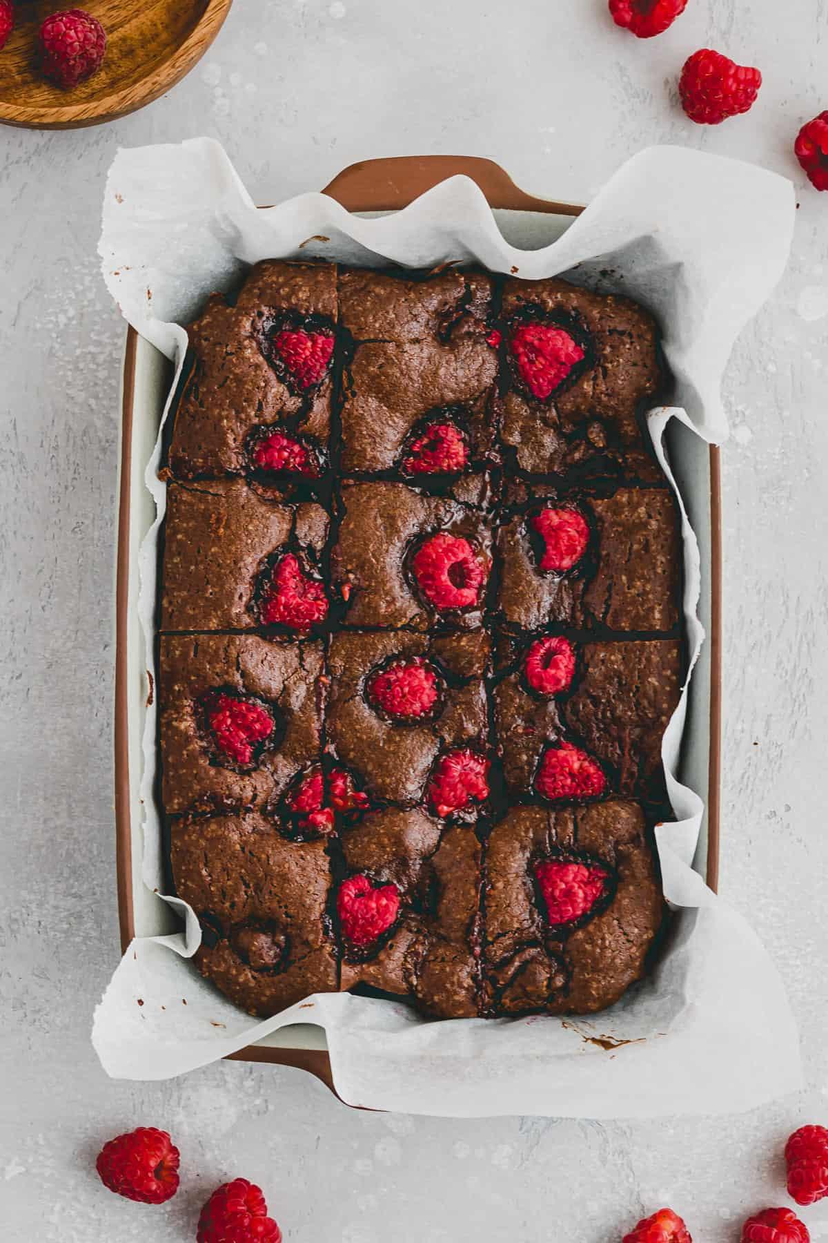 sliced raspberry brownies in a baking pan