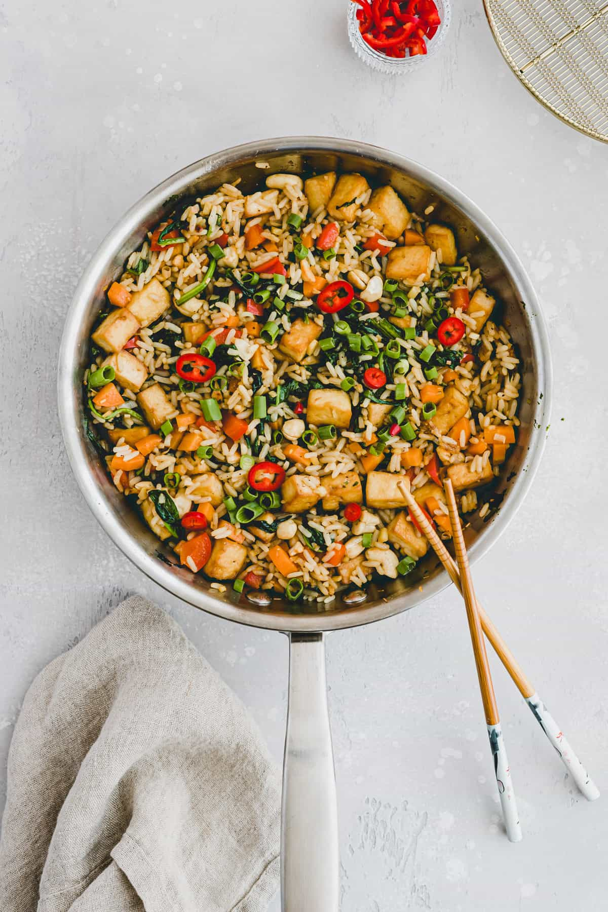 vegan fried rice with tofu and vegetables in a skillet