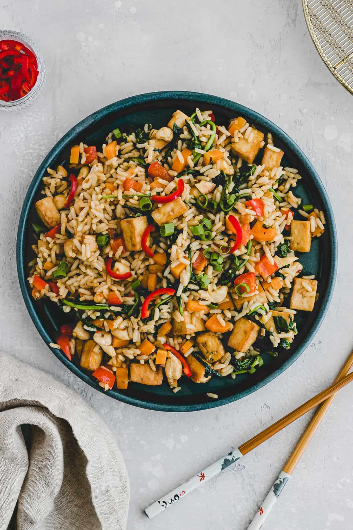 tofu fried rice on a blue plate
