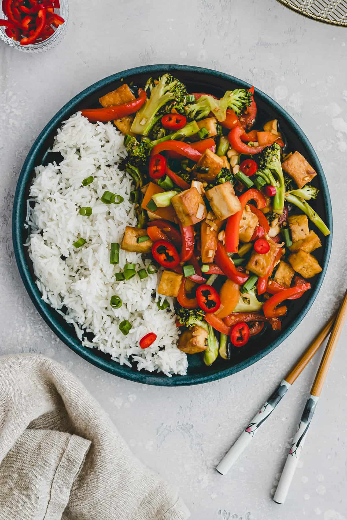 tofu veggie stir fry on a blue plate