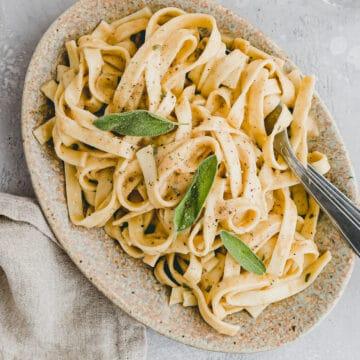 vegan pumpkin alfredo pasta on a plate