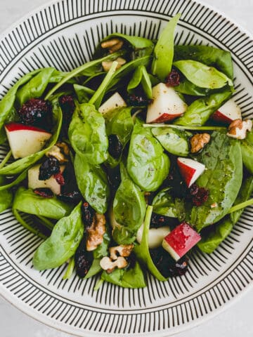 spinach apple salad in a bowl